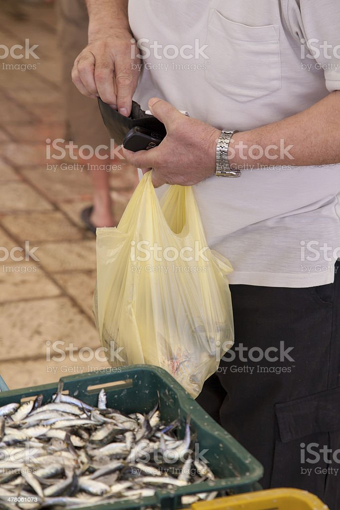 Buying fresh fish on market royalty-free stock photo