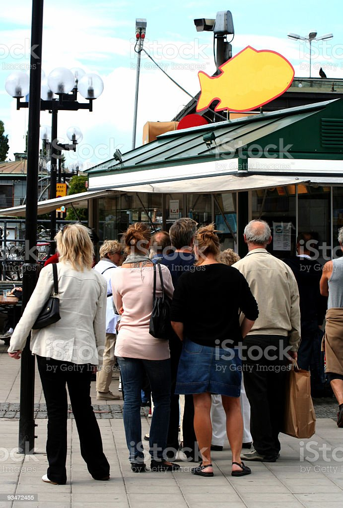Buying fried baltic herring, healthy fast food in Stockholm. royalty-free stock photo