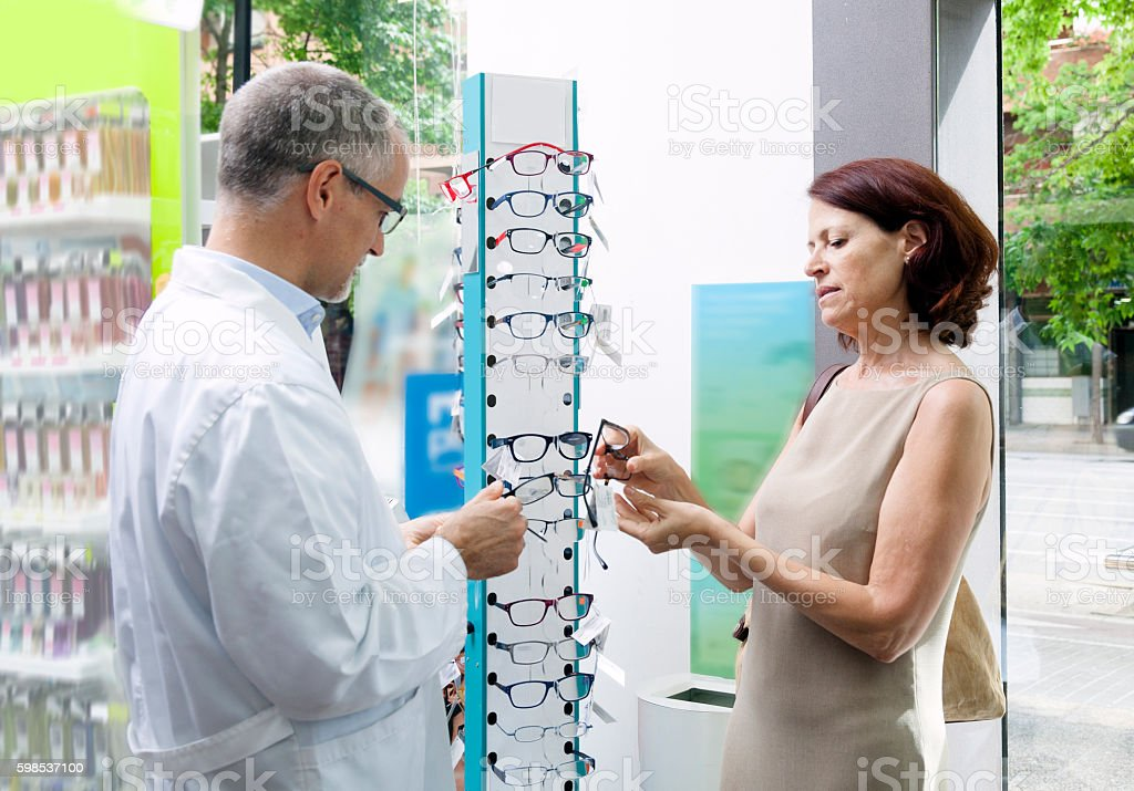 Buying glasses at a pharmacy stock photo