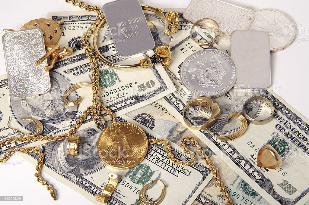 Buying gold and silver royalty-free stock photo