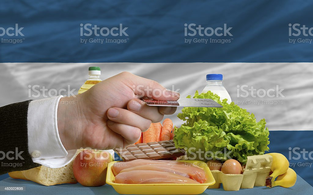 buying groceries with credit card in el salvador stock photo