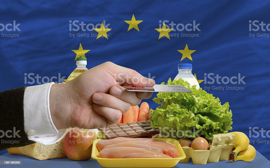 buying groceries with credit card in europe royalty-free stock photo