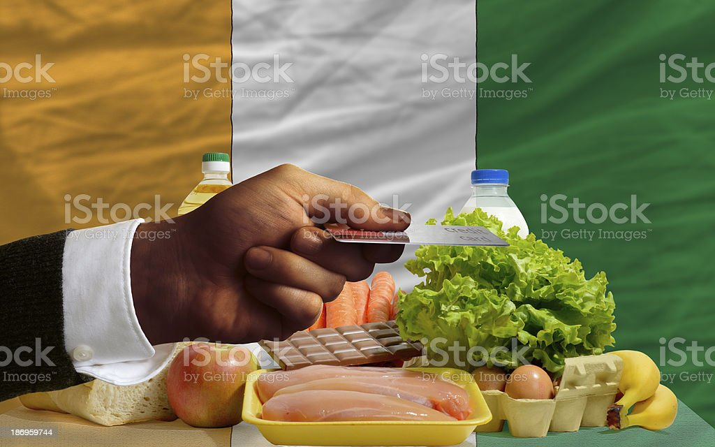 buying groceries with credit card in ivory coast royalty-free stock photo