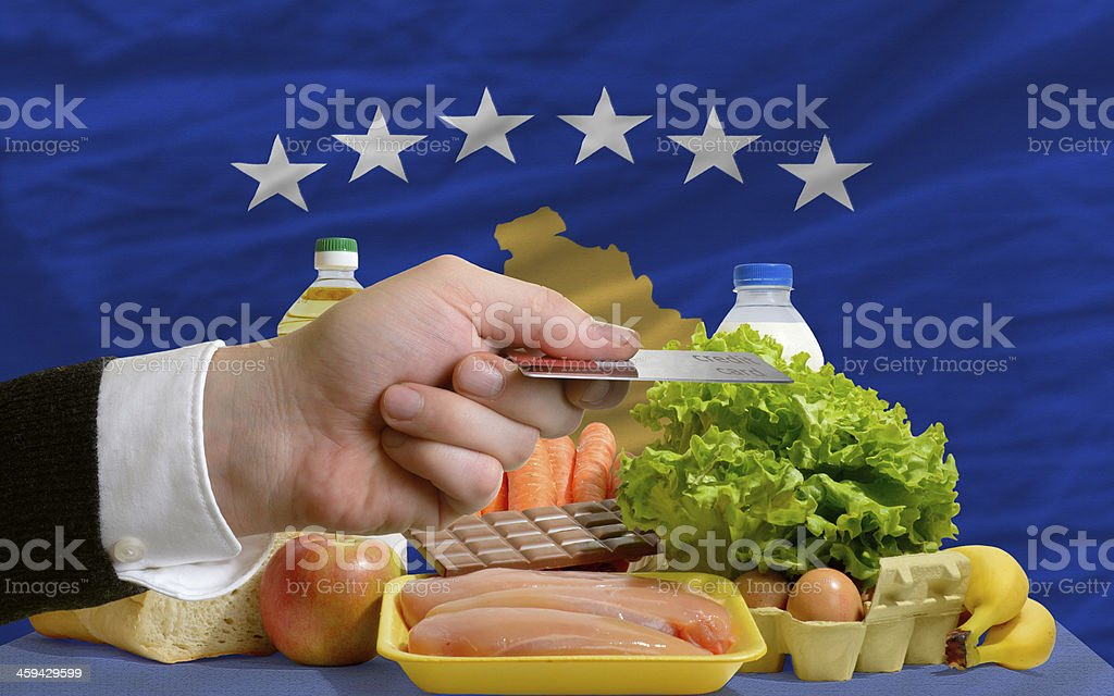 buying groceries with credit card in kosovo stock photo