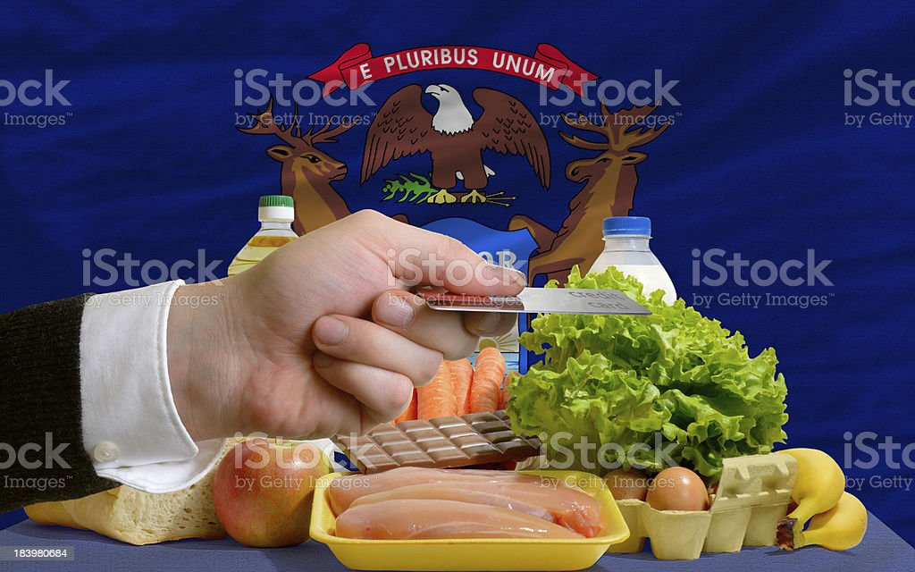 buying groceries with credit card in us state of michigan royalty-free stock photo
