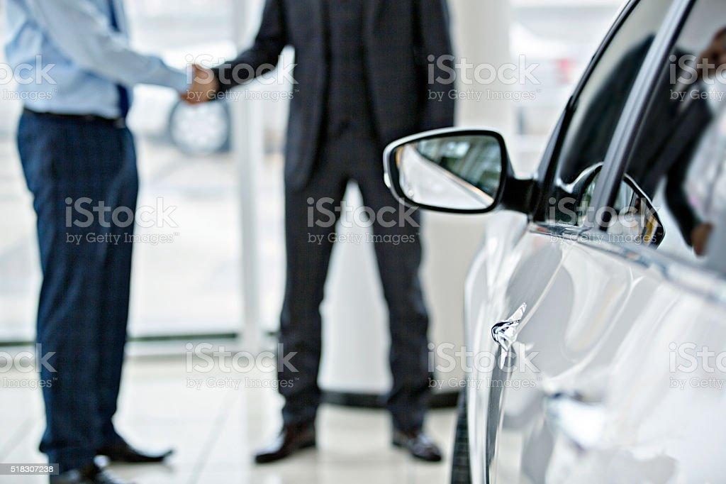 Buying new car at car showroom stock photo