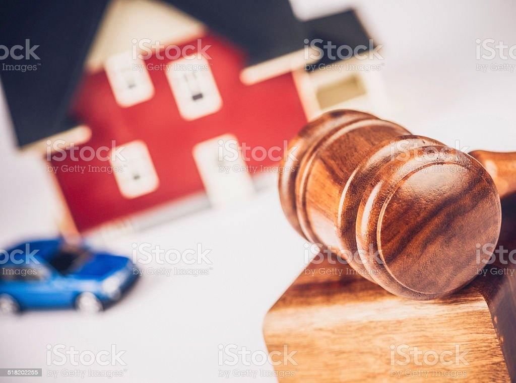 Buying or Selling a Home: Gavel with Real Estate stock photo