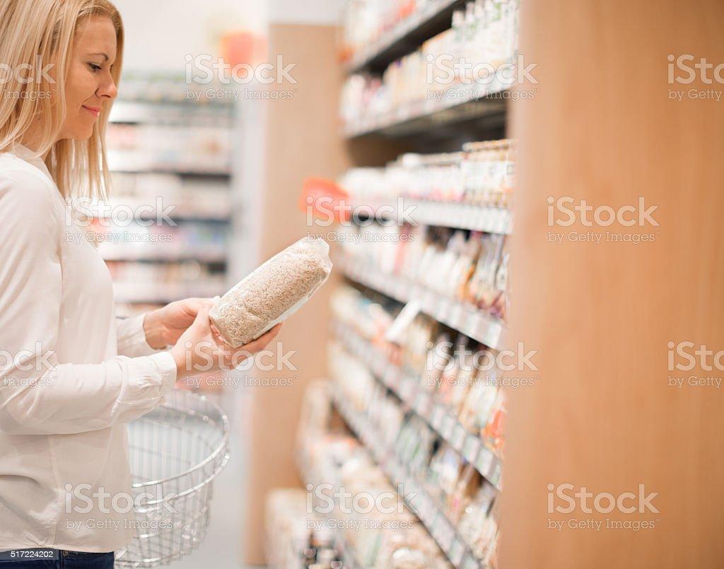 Buying organic rice stock photo