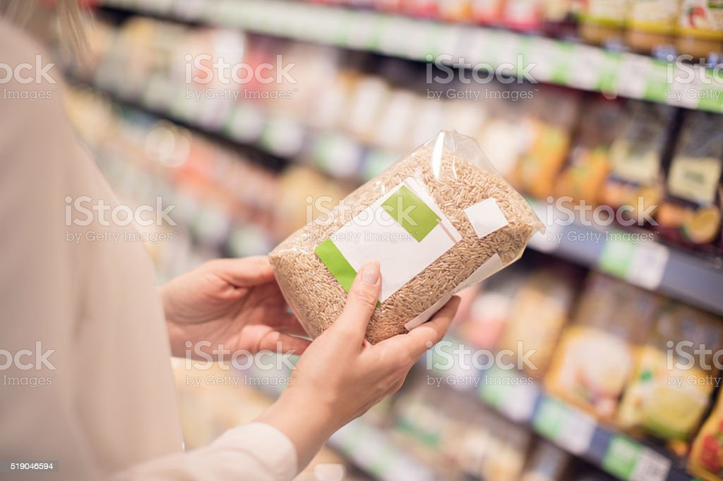 Buying organic rice stock photo
