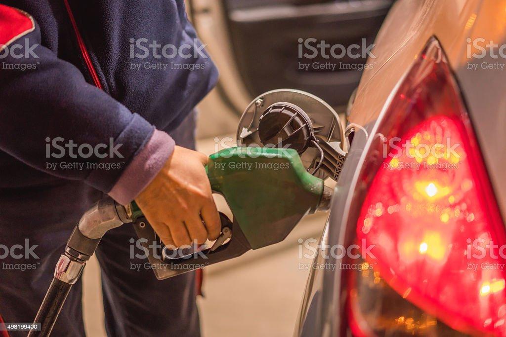 Buying petrol pumping gas global warming car stock photo