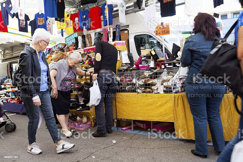 Buying shoes on market in Varese royalty-free stock photo
