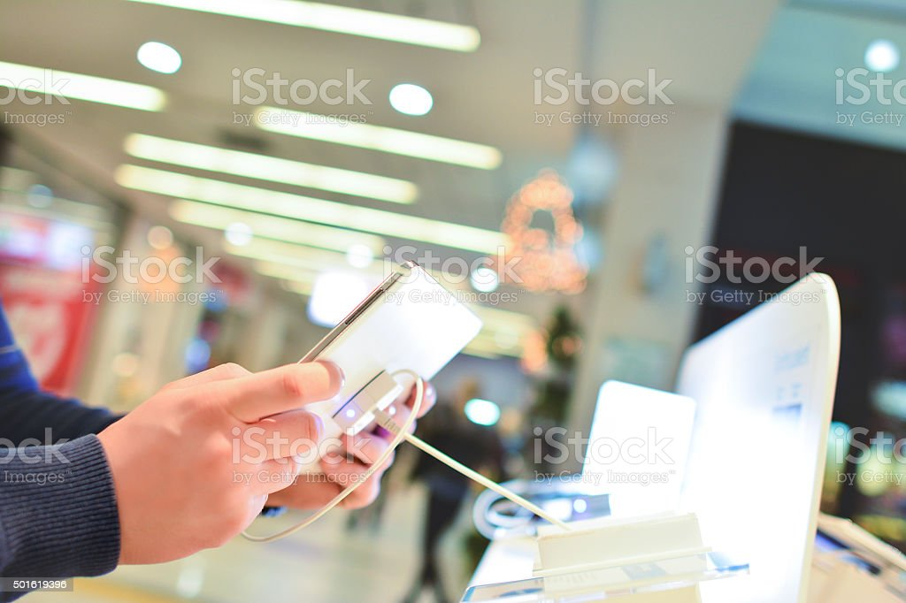 Buying Smartphone stock photo