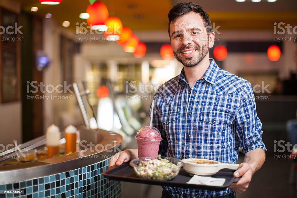 Buying some food at a restaurant stock photo