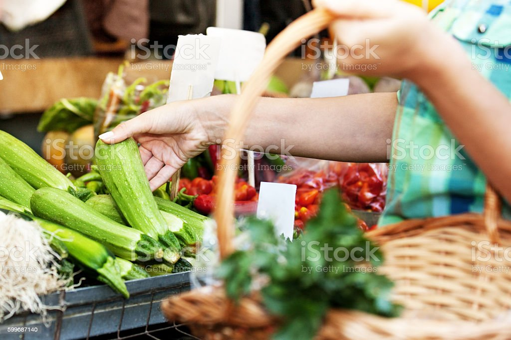 Buying Vegetables at Green Market stock photo