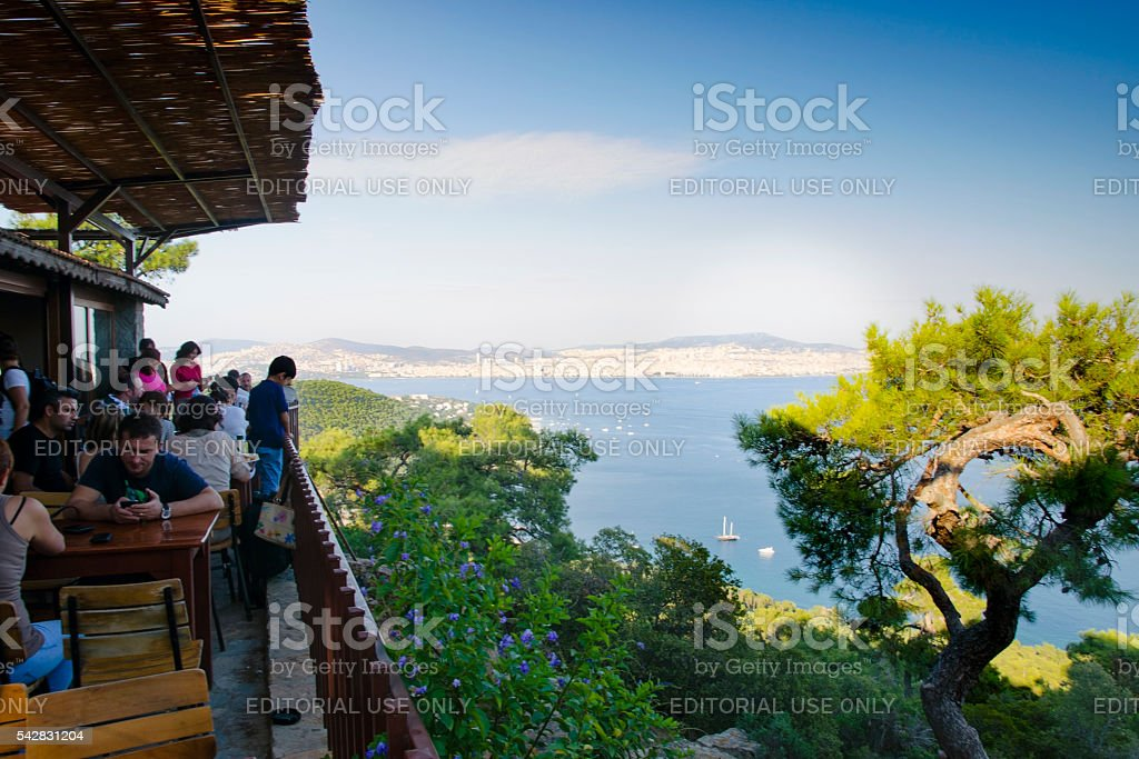 Buyukada Visitors to the Yucetepe is seen restaurant. stock photo