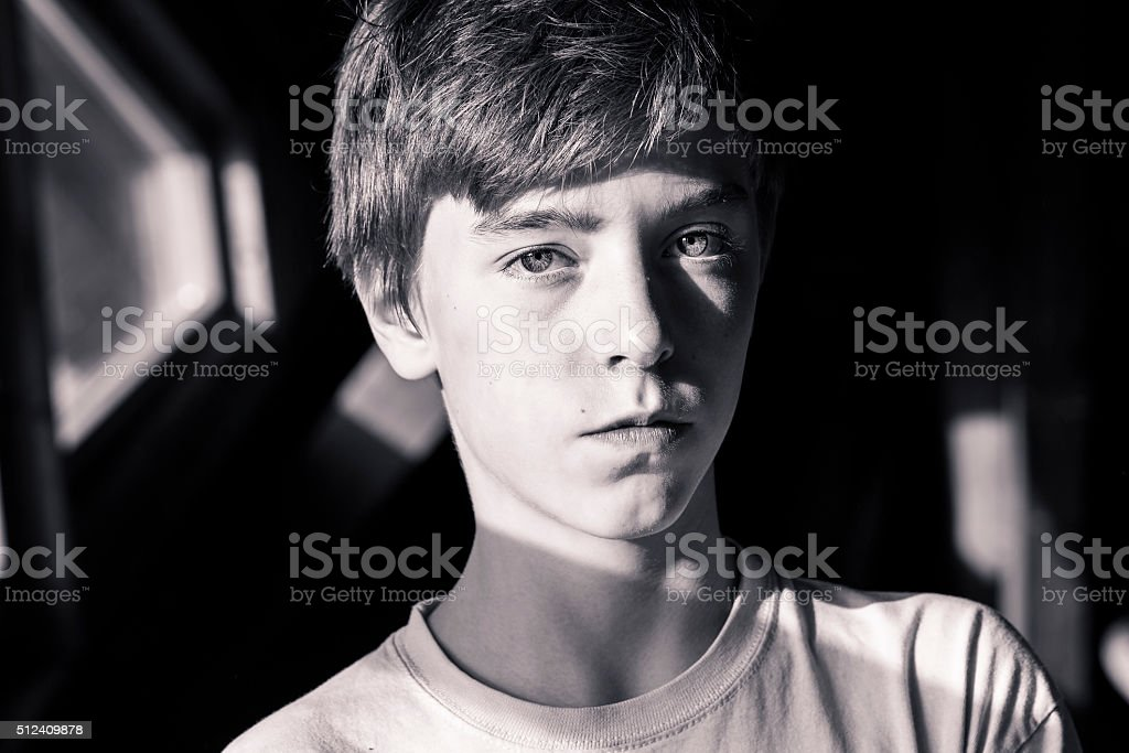 bw portrait of a beautiful teenage boy stock photo