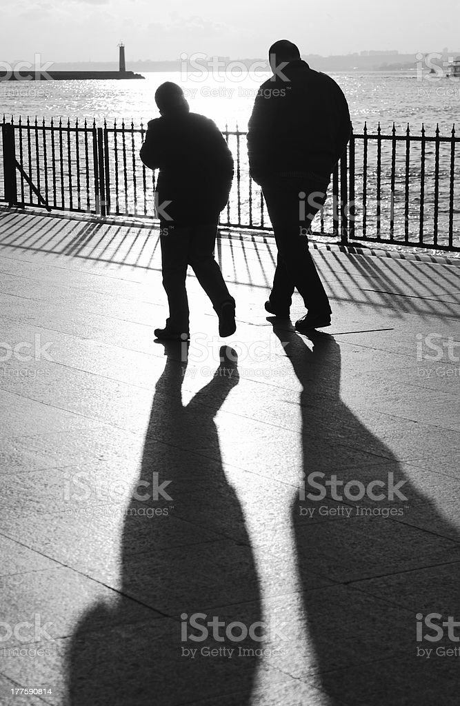 Bw: Walking in the Shadows royalty-free stock photo