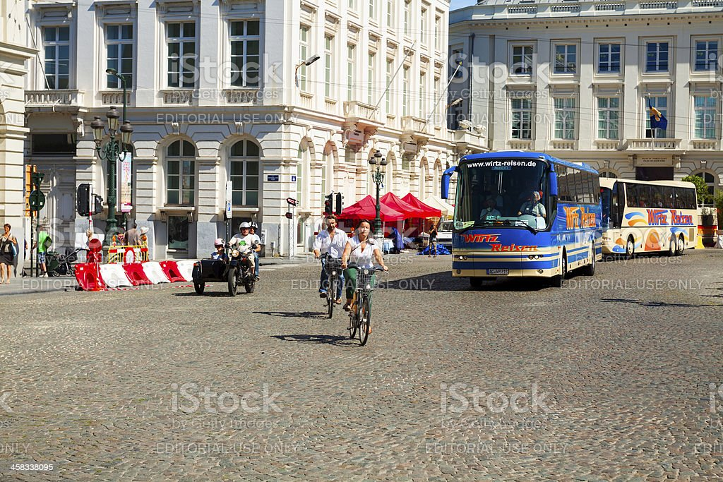 By bicycle, motorbike and bus royalty-free stock photo