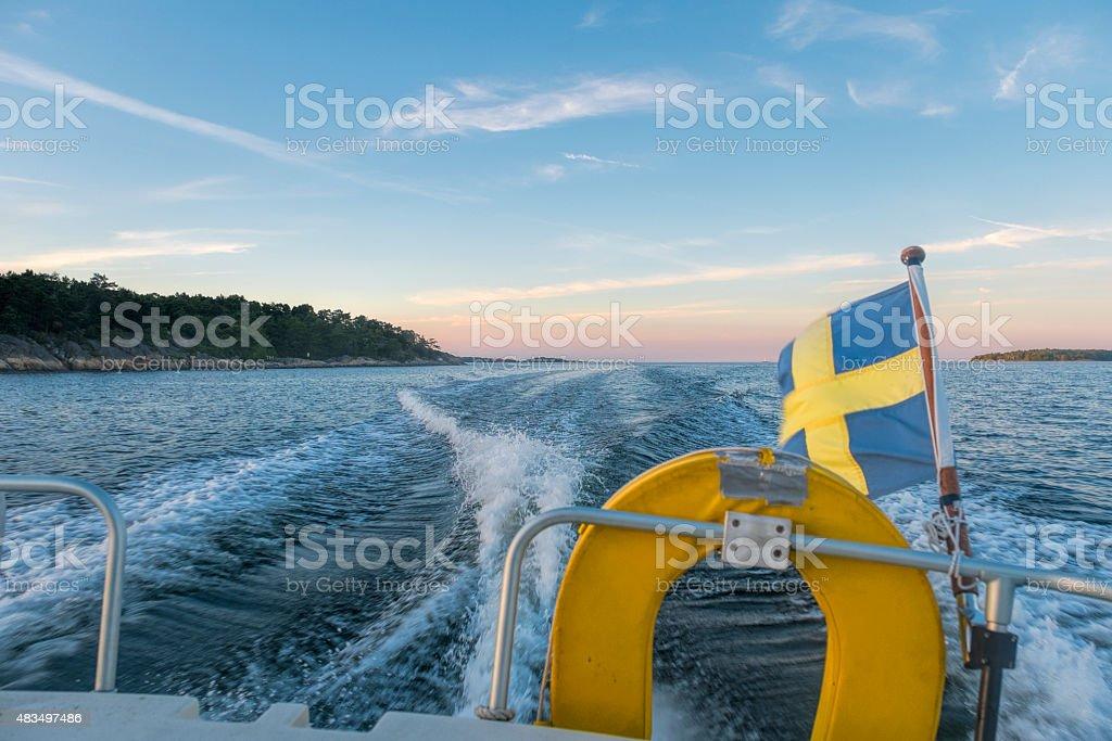 By boat in sunset, Stockholm Archipelago, Sweden. stock photo