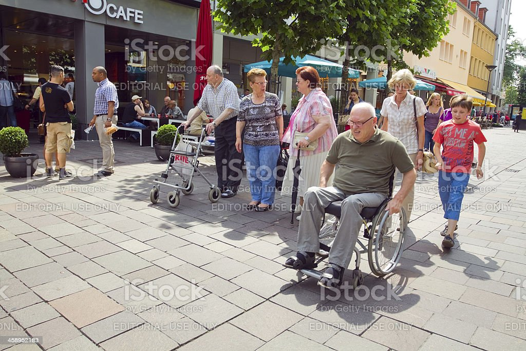 By feet, wheel chair and walking frame stock photo