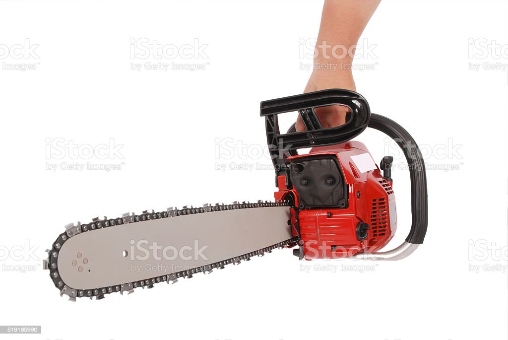 By one hand holding a chainsaw stock photo