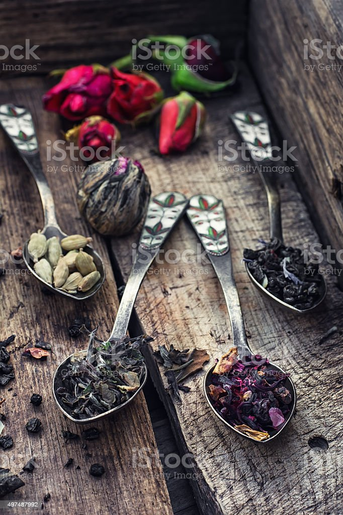 by spilling tea spoons stock photo
