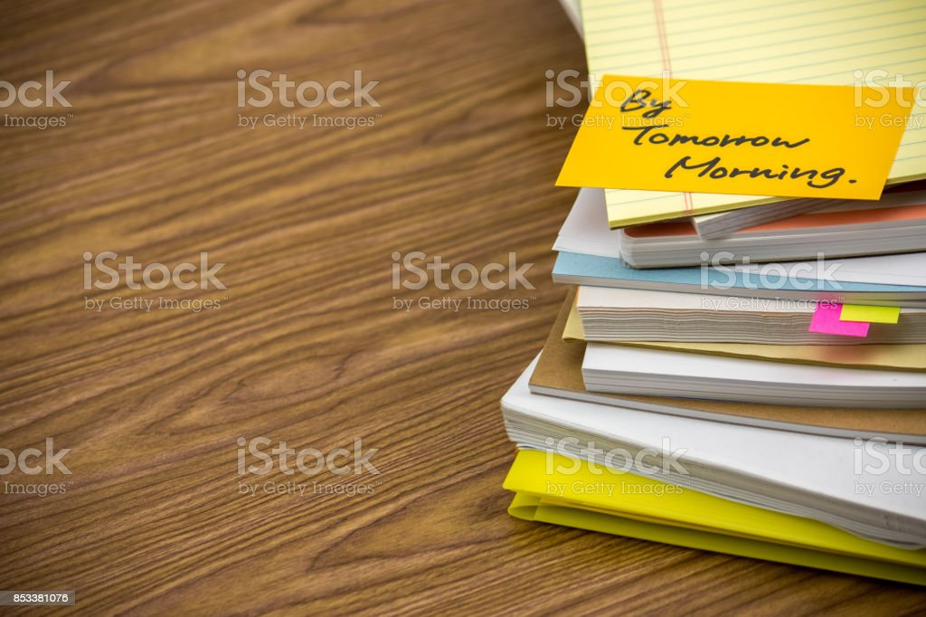 By Tomorrow Morning; The Pile of Business Documents on the Desk stock photo