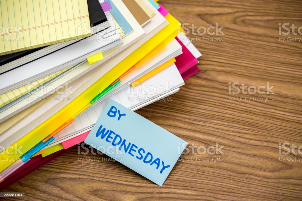 By Wednesday; The Pile of Business Documents on the Desk stock photo