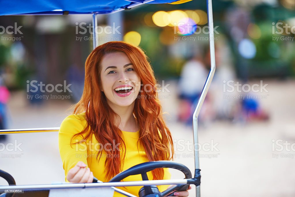 bycicle moment, woman laughing stock photo