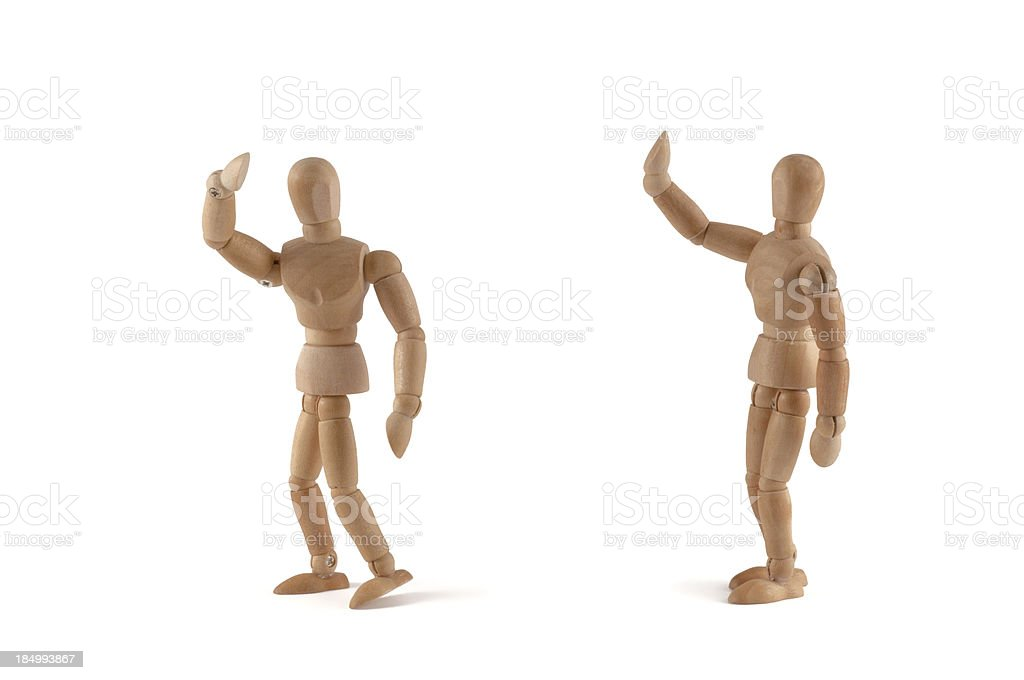 Bye - wooden mannequins waves to somebody stock photo