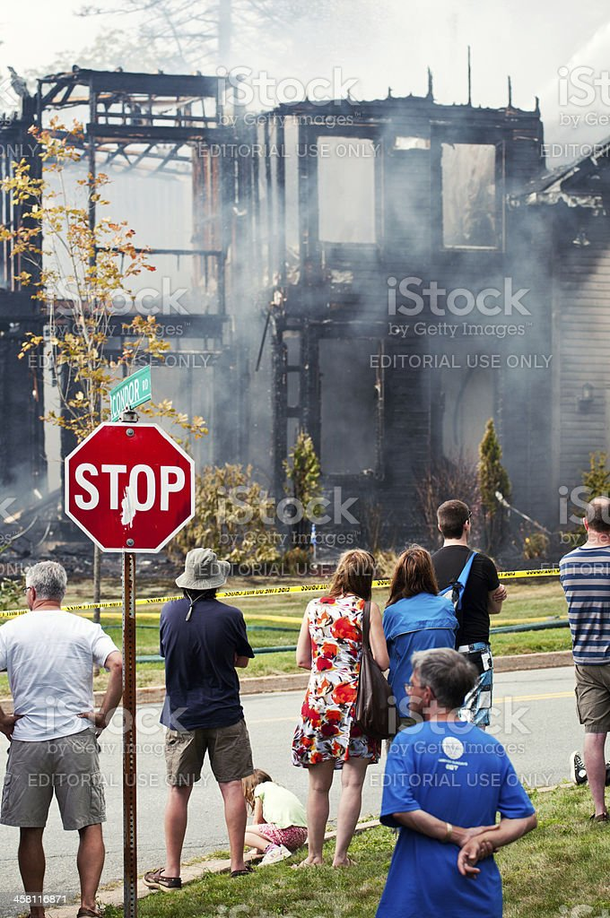 Bystanders at House Fire stock photo
