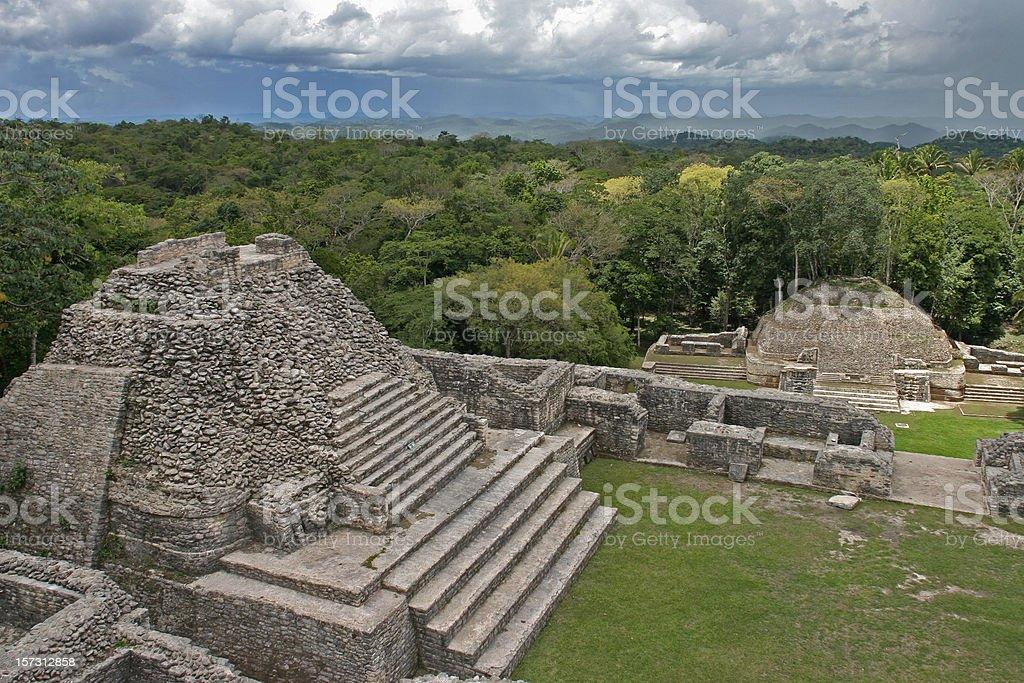 Caana Maya Pyramid overlooks storm and rainforest Caracol Ruins Belize royalty-free stock photo