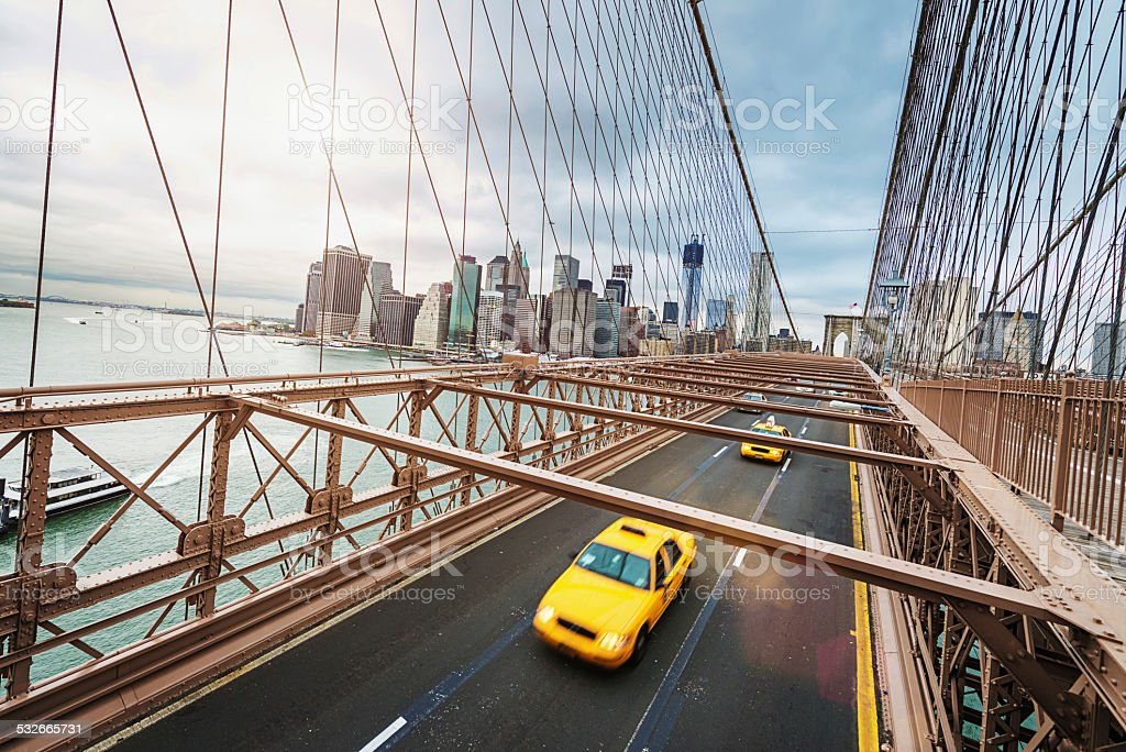 Cab on Brooklyn Bridge in Front of Manhattan Skyline stock photo