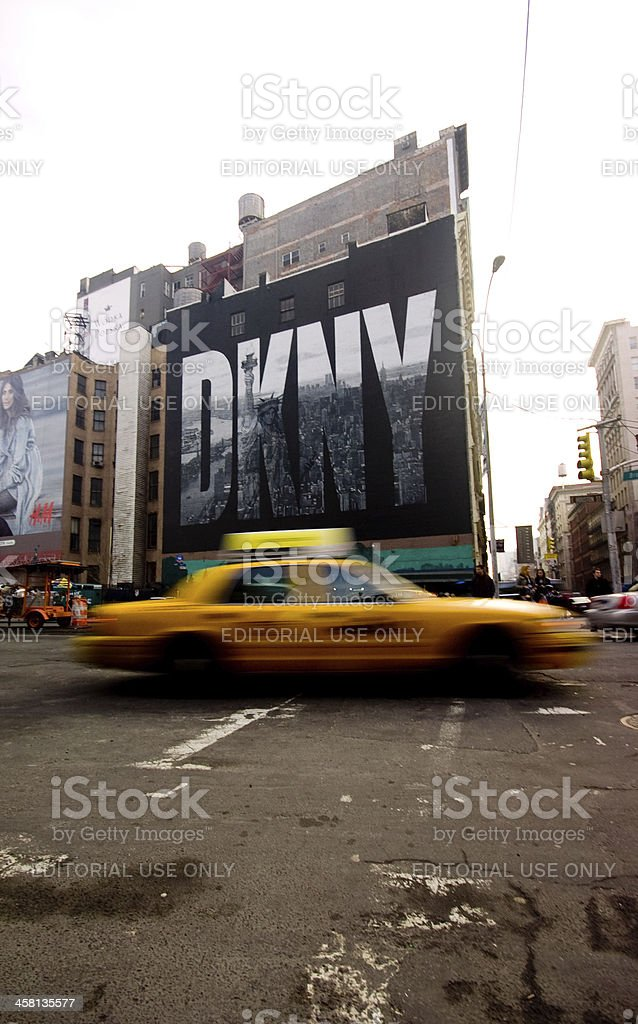 Cab under the DKNY billboard on Houston and Broadway, NYC stock photo