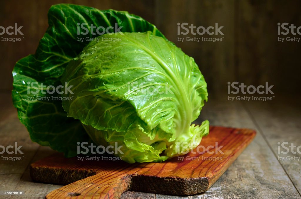 Cabbage head on cutting board. stock photo