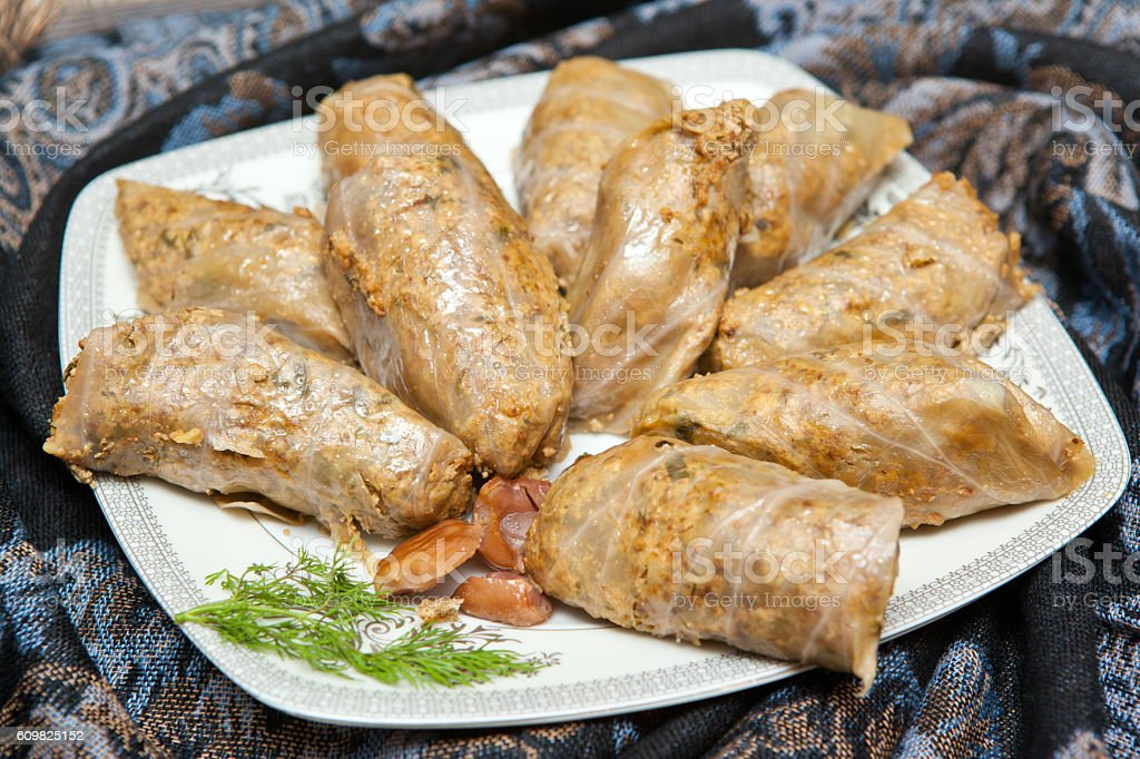 Cabbage rolls in Azerbaijani with walnut and chestnut stuffing o stock photo