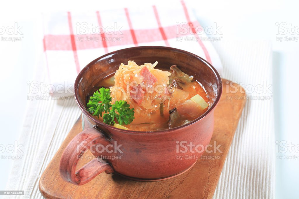 Cabbage soup in a clay pot stock photo