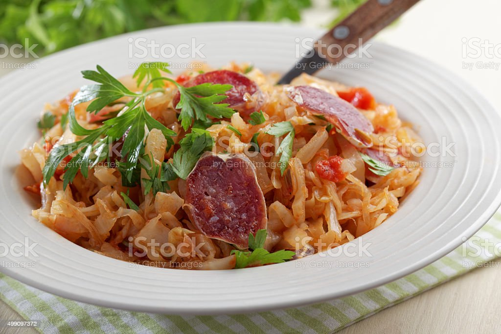Cabbage stew with fuet sausage stock photo
