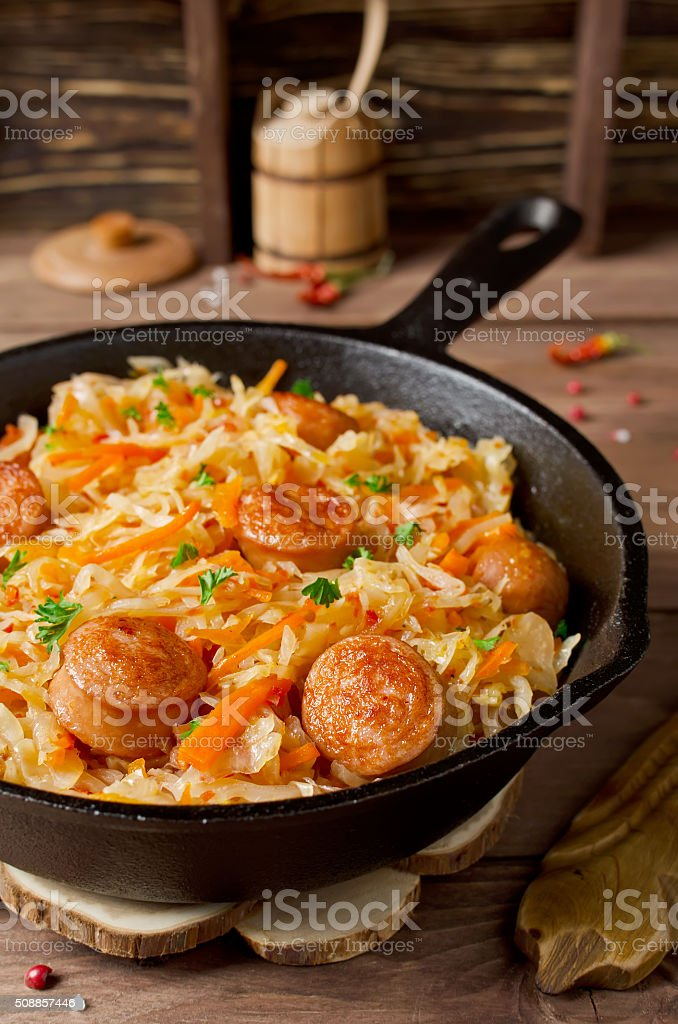 Cabbage stew with grilled sausage stock photo