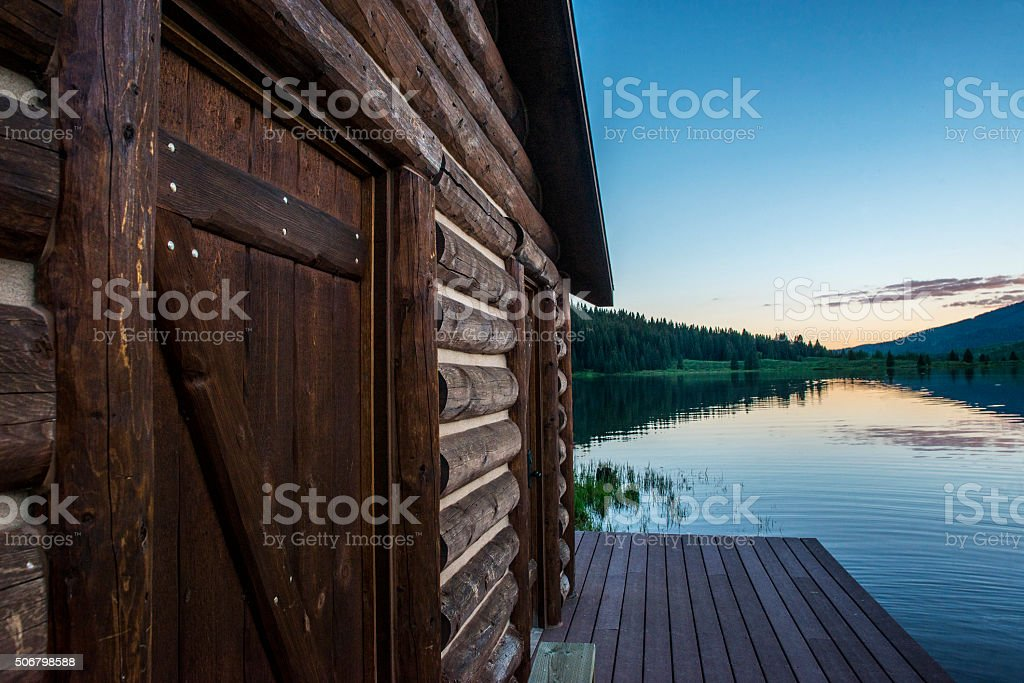 Cabin and Mountain reflection on lake in Colorado stock photo