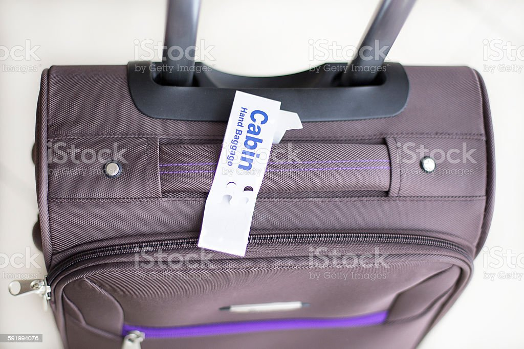Cabin Hand Baggage On The Floor - Stock Image 0030 stock photo