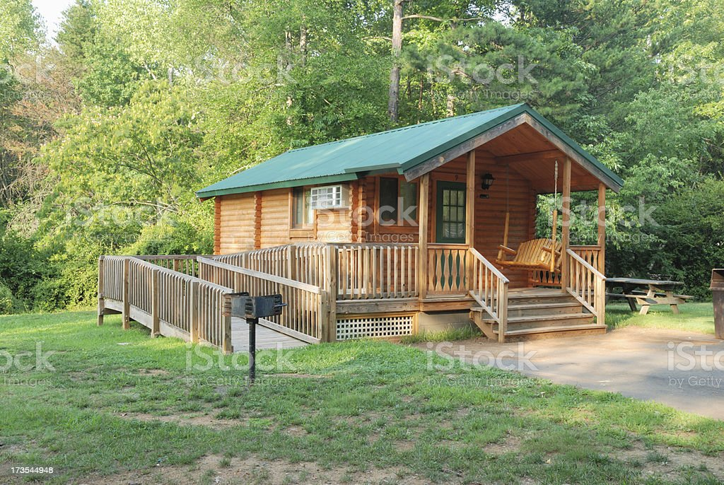 Cabin in the middle of the woods on sunny day royalty-free stock photo
