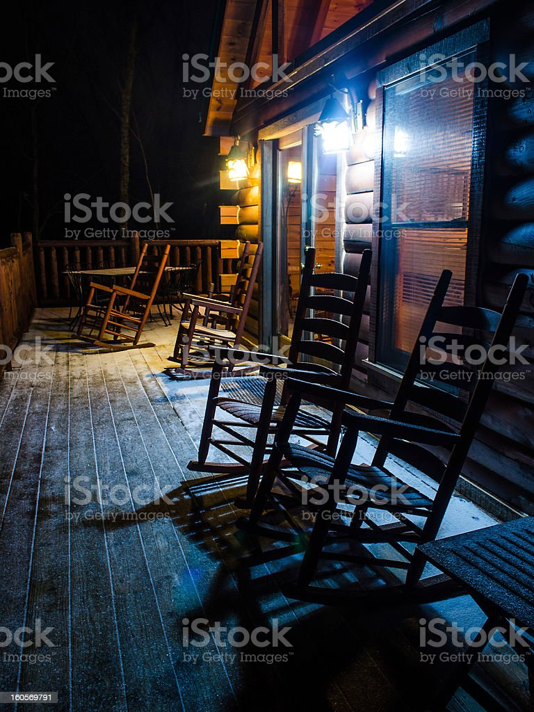 Cabin In The Night With Snow And Chairs royalty-free stock photo