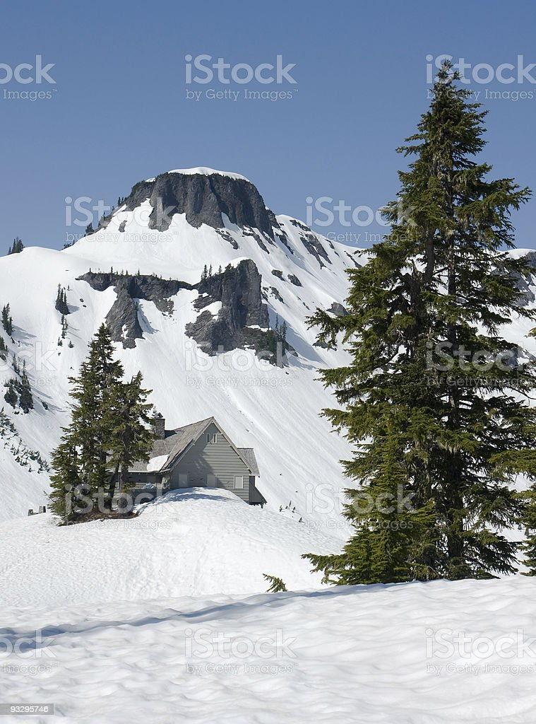 Cabin in winter mountain wilderness stock photo