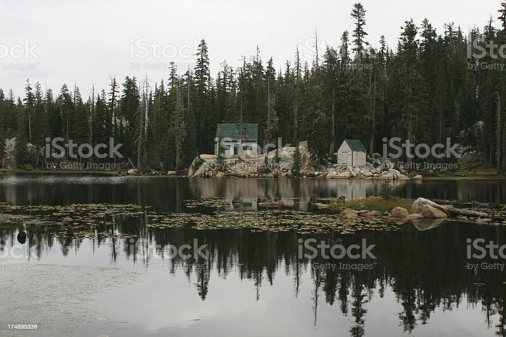 Cabin on lake stock photo