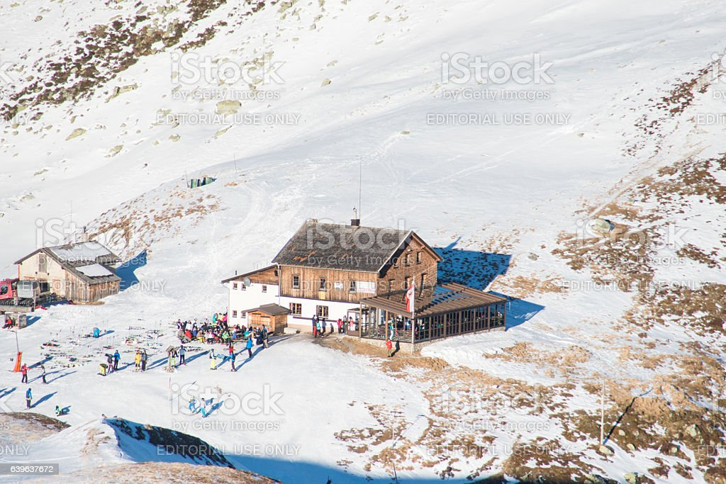 cabin on snowy mountain peaks at zillertal stock photo