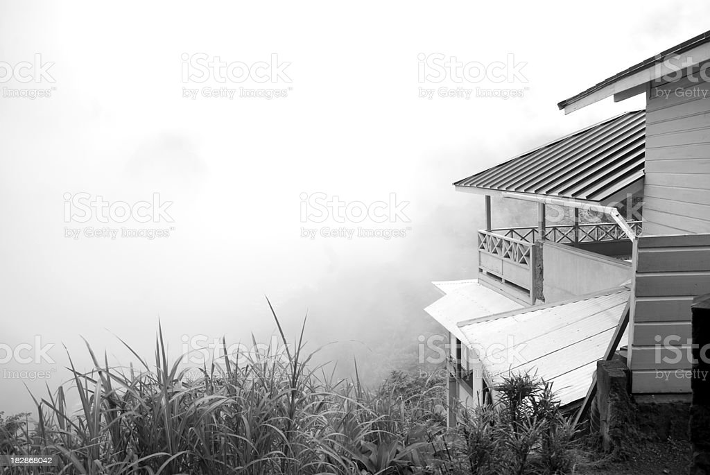 cabin overlooking fog ridden valley stock photo