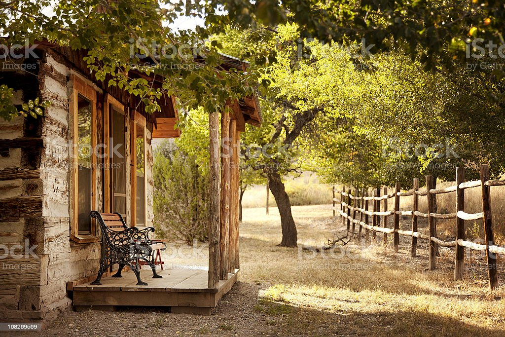 Cabin Porch with Trees and Fence stock photo