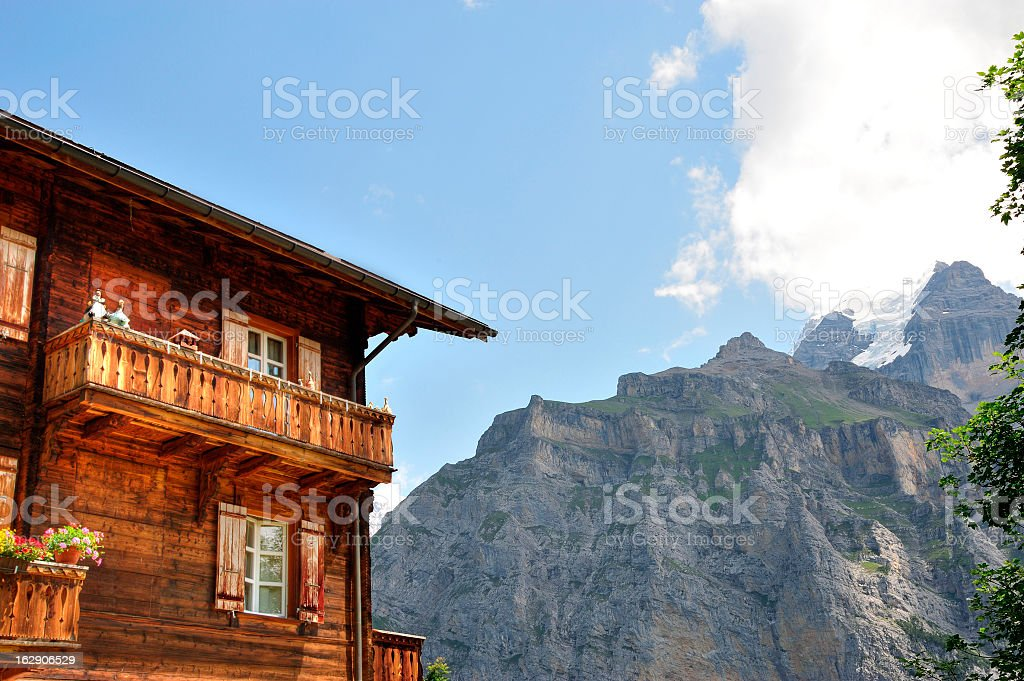 Cabin with Mountain Background stock photo