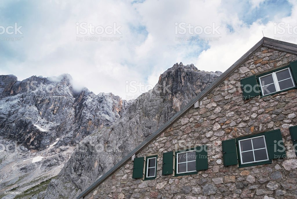 cabin with mountain stock photo